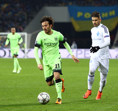 silva: KYIV, UKRAINE - FEBRUARY 24, 2016: David Silva of Manchester City in Green controls a ball during UEFA Champions League Round of 16 football match against FC Dynamo Kyiv at NSC Olimpiyskyi stadium
