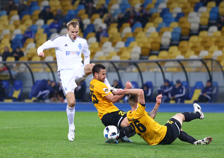 gusev: KYIV, UKRAINE - March 1, 2016: Oleh Gusev in White kicks the ball during Ukrainian Cup quarterfinal game against FC Oleksandria at NSC Olimpiyskyi stadium in Kyiv