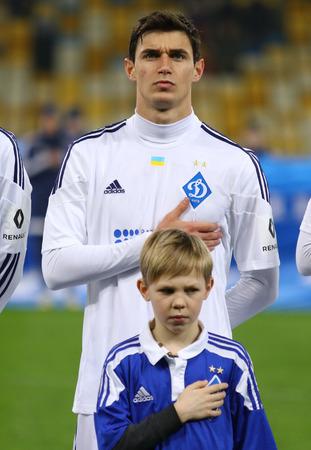 KYIV, UKRAINE - March 1, 2016: Roman Yaremchuk of FC Dynamo Kyiv listen to National Ukrainian anthem before Ukrainian Cup quarterfinal game against FC Oleksandria at NSC Olimpiyskyi stadium in Kyiv