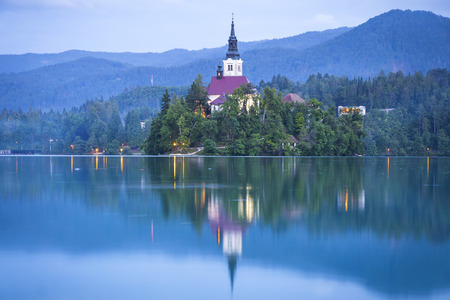 atmospheric: Atmospheric picturesque view of Church of the Assumption on the island of Bled lake, Slovenia