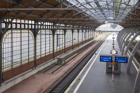 railtrack: LUBECK, GERMANY - NOVEMBER 7, 2013: Lubeck Hbf railway station. Is the main railway station of Hanseatic city of Lubeck Schleswig-Holstein state,opened at 1908 and serving about 31000 visitors daily Editorial