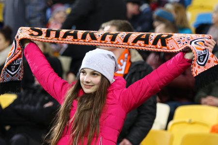 rsc: LVIV, UKRAINE - March 10, 2016: FC Shakhtar Donetsk supporter shows her support during UEFA Europa League Round of 16 game against RSC Anderlecht at Lviv Arena in Lviv. Shakhtar won 3-1