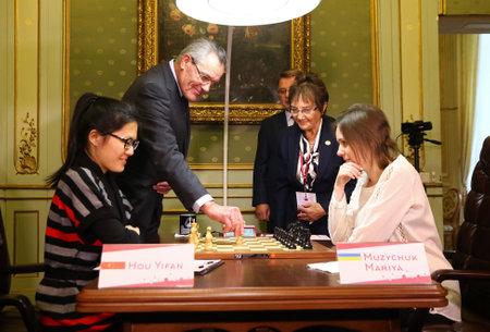 first move: LVIV, UKRAINE - MARCH 11, 2016: Rector of Lviv Polytechnic National University Yuriy Bobalo makes the first move of 7th game of FIDE Womens World Chess Championship Match Mariya Muzychuk v Hou Yifan