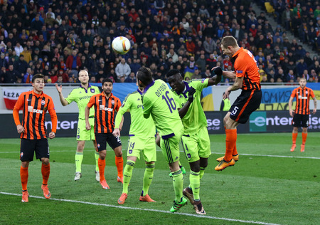 rsc: LVIV, UKRAINE - March 10, 2016: Olexandr Kucher of FC Shakhtar Donetsk (R, #5) scores during the UEFA Europa League Round of 16 game against RSC Anderlecht at Lviv Arena. Shakhtar won 3-1 Editorial