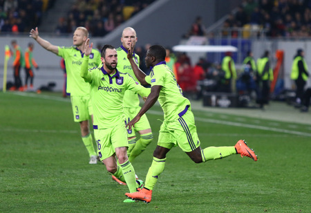 react: LVIV, UKRAINE - March 10, 2016: RSC Anderlecht players react after scored during the UEFA Europa League Round of 16 game against FC Shakhtar Donetsk at Lviv Arena