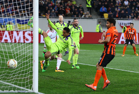 rsc: LVIV, UKRAINE - March 10, 2016: Taison of FC Shakhtar Donetsk (R, on the background) scores during the UEFA Europa League Round of 16 game against RSC Anderlecht at Lviv Arena. Shakhtar won 3-1