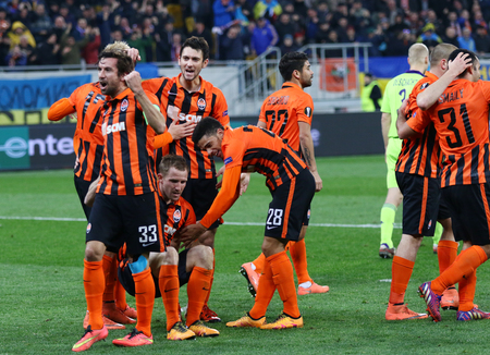 winning pitch: LVIV, UKRAINE - March 10, 2016: FC Shakhtar Donetsk players react after scored during the UEFA Europa League Round of 16 game against RSC Anderlecht at Lviv Arena. Shakhtar won 3-1 Editorial