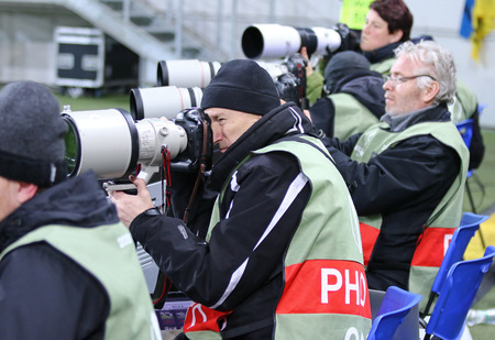 rsc: LVIV, UKRAINE - March 10, 2016: Football photographers at work during the UEFA Europa League Round of 16 game FC Shakhtar Donetsk vs RSC Anderlecht at Lviv Arena stadium Editorial
