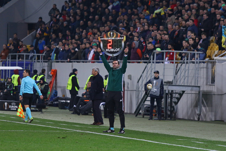 rsc: LVIV, UKRAINE - March 10, 2016: Assistant referee show an indicator board with additional time during UEFA Europa League Round of 16 game FC Shakhtar Donetsk vs RSC Anderlecht at Arena Lviv stadium