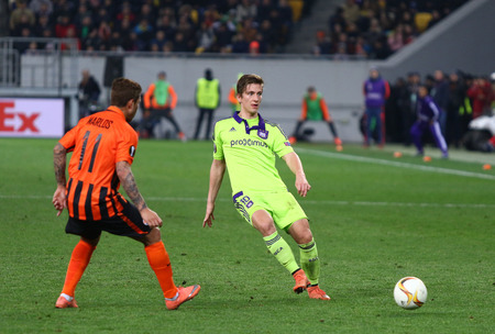 rsc: LVIV, UKRAINE - March 10, 2016: Marlos of FC Shakhtar Donetsk (L) fights for a ball with Dennis Praet of RSC Anderlecht during their UEFA Europa League Round of 16 game at Lviv Arena stadium in Lviv