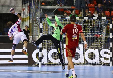 igor: KYIV, UKRAINE - MARCH 19, 2016: Igor Soroka of HC Motor (L) attacks during the 201516 VELUX EHF Champions League Last 16 Handball game against MVM Veszprem at Ice Terminal Brovary in Kyiv, Ukraine