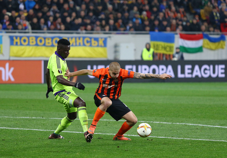rsc: LVIV, UKRAINE - March 10, 2016: Yaroslav Rakitskiy of FC Shakhtar Donetsk (R) fights for a ball with Stefano Okaka of RSC Anderlecht during their UEFA Europa League Round of 16 game at Lviv Arena Editorial