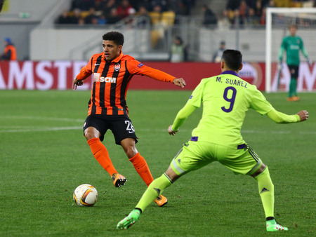 rsc: LVIV, UKRAINE - March 10, 2016: Taison of FC Shakhtar Donetsk (L) fights for a ball with Matias Suarez of RSC Anderlecht during their UEFA Europa League Round of 16 game at Lviv Arena stadium in Lviv