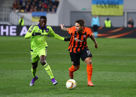 rsc: LVIV, UKRAINE - March 10, 2016: Marlos of FC Shakhtar Donetsk (R) fights for a ball with Frank Acheampong of RSC Anderlecht during their UEFA Europa League Round of 16 game at Lviv Arena stadium