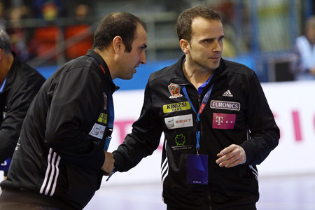 handball: KYIV, UKRAINE - MARCH 19, 2016: Xavier Sabate Caviedes, head coach of MVM Veszprem team (R) during the 201516 VELUX EHF Champions League Last 16 Handball game against HC Motor at Ice Terminal Brovary