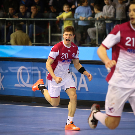 reacts: KYIV, UKRAINE - MARCH 19, 2016: Artem Kozakevych of HC Motor reacts after scored a goal during the 201516 VELUX EHF Champions League Handball game against MVM Veszprem at Ice Terminal Brovary Editorial