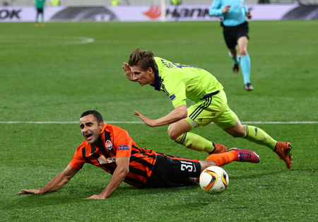 rsc: LVIV, UKRAINE - March 10, 2016: Ismaily of FC Shakhtar Donetsk (L) fights for a ball with Dennis Praet of RSC Anderlecht during their UEFA Europa League Round of 16 game at Lviv Arena stadium in Lviv