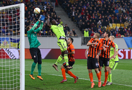 rsc: LVIV, UKRAINE - March 10, 2016: FC Shakhtar Donetsk (in orange colours) and RSC Anderlecht (in green) players fight for a ball during their UEFA Europa League Round of 16 game at Lviv Arena stadium Editorial