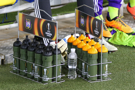 rsc: LVIV, UKRAINE - March 10, 2016: Bottles of water with UEFA Europa League logo on the grass during UEFA Europa League Round of 16 game FC Shakhtar Donetsk vs RSC Anderlecht at Arena Lviv stadium
