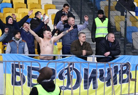 ultras: KYIV, UKRAINE - MARCH 28, 2016: Ukrainian supporters show their support during Friendly match between Ukraine and Wales at NSC Olympic stadium in Kyiv, Ukraine