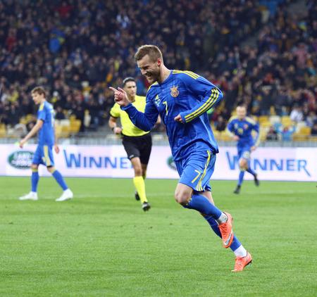 winning pitch: KYIV, UKRAINE - MARCH 28, 2016: Andriy Yarmolenko of Ukraine reacts after scored a goal during Friendly match against Wales at NSC Olympic stadium in Kyiv, Ukraine. Ukraine won 1-0