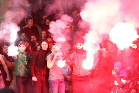 ultras: KYIV, UKRAINE - MARCH 28, 2016: Ukrainian ultra supporters (ultras) burn flares during Friendly match between Ukraine and Wales at NSC Olympic stadium in Kyiv, Ukraine. Ukraine won 1-0 Editorial