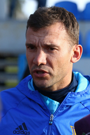 camping pitch: KYIV, UKRAINE - MARCH 27, 2016: Coach assistant Andriy Shevchenko gives an interview during open training of Ukraine National Football Team before the game against Wales. Koncha-Zaspa Training Camp