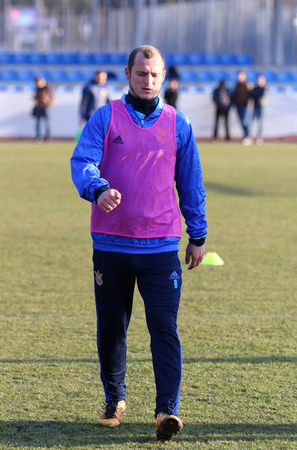 camping pitch: KYIV, UKRAINE - MARCH 27, 2016: Roman Zozulya looks on during open training session of Ukraine National Football Team before the game against Wales. Koncha-Zaspa Training Camp, Kyiv, Ukraine