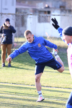 camping pitch: KYIV, UKRAINE - MARCH 27, 2016: Ivan Petryak stretches during open training session of Ukraine National Football Team before the game against Wales. Koncha-Zaspa Training Camp, Kyiv, Ukraine Editorial