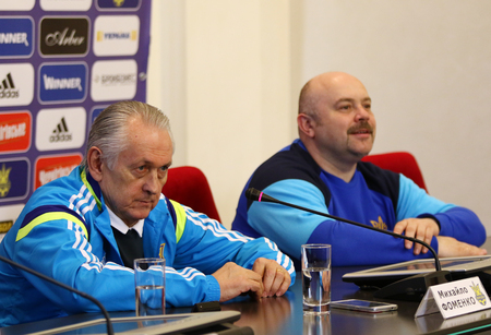 mikhail: KYIV, UKRAINE - MARCH 27, 2016: Ukraine National Team head coach Mykhaylo Fomenko (Left) attends press-conference before the friendly game against Wales. Koncha-Zaspa Training Camp, Kyiv, Ukraine Editorial