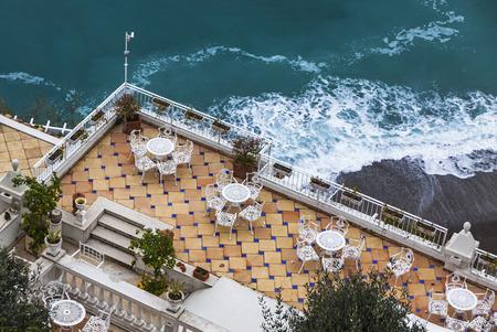 seacoast: Empty open-air restaurant at Amalfi seacoast, Italy Stock Photo