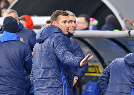 reacts: KYIV, UKRAINE - MARCH 28, 2016: Coach assistant Andriy Shevchenko of Ukraine reacts after the Friendly match against Wales at NSC Olympic stadium in Kyiv, Ukraine. Ukraine won 1-0