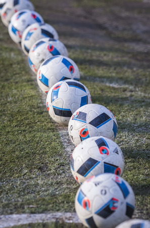 adidas: KYIV, UKRAINE - MARCH 28, 2016: Official match balls of the UEFA EURO 2016 Tournament (Adidas Beau Jeu) on the grass during the Open training session of Ukraine National Football Team