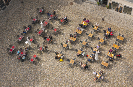 top 7: KONSTANZ, GERMANY - MAy 7, 2013: People sitting at outdoors cafe on the Munsterplatz square in old town of Konstanz. Top view from the Tower of Konstanz Cathedral