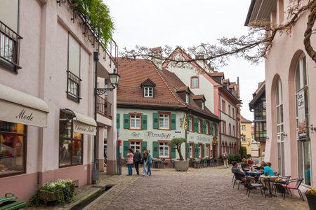 freiburg: FREIBURG im BREISGAU, GERMANY - MAY 1, 2013: Old town street in Freiburg im Breisgau, a city in the south-western part of Germany in the Baden-Wurttemberg state Editorial