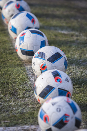 beau: KYIV, UKRAINE - MARCH 28, 2016: Official match balls of the UEFA EURO 2016 Tournament (Adidas Beau Jeu) on the grass during the Open training session of Ukraine National Football Team