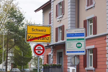 demarcation: KONSTANZ, GERMANY - MAY 7, 2013: The national border between Germany and Switzerland in Konstanz city. Swiss city Kreuzlingen on the background