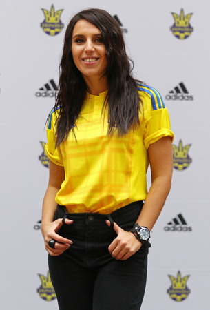 adidas: KYIV, UKRAINE - MARCH 9, 2016: Singer Jamala (who will represent Ukraine in Eurovision Song Contest 2016) poses during presentation of the New jerseys of the National Football Team of Ukraine