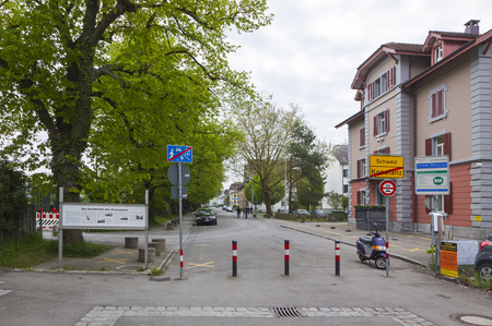 national border: KONSTANZ, GERMANY - MAY 7, 2013: The national border between Germany and Switzerland in Konstanz city. Swiss city Kreuzlingen on the background