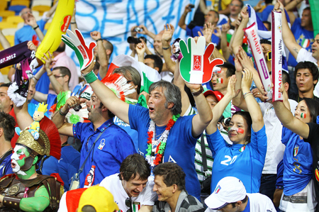 ultras: KYIV, UKRAINE - JULY 1, 2012: Italy national football team supporters show their support during UEFA EURO 2012 Championship final game at NSC Olympic stadium in Kyiv, Ukraine