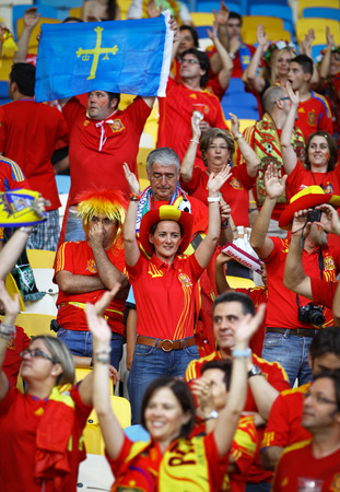 KYIV, UKRAINE - JULY 1, 2012: Spain national football team supporters show their support during UEFA EURO 2012 Championship final game at NSC sports competition stadium in Kyiv, Ukraine