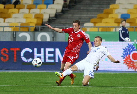gusev: KYIV, UKRAINE - APRIL 10, 2016: Oleh Gusev of Dynamo Kyiv (R) fights for a ball with Oleg Gumenyuk of Volyn Lutsk during their Ukrainian Premier League game at NSC Olympic stadium in Kyiv