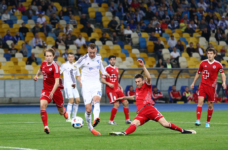 scores: KYIV, UKRAINE - APRIL 10, 2016: Andriy Yarmolenko of Dynamo Kyiv (in White) scores a goal during Ukrainian Premier League game against Volyn Lutsk at NSC Olympic stadium in Kyiv Editorial