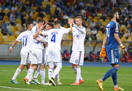 react: KYIV, UKRAINE - APRIL 10, 2016: FC Dynamo Kyiv players react after scored a goal during Ukrainian Premier League game against Volyn Lutsk at NSC Olympic stadium in Kyiv