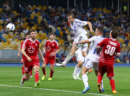 gusev: KYIV, UKRAINE - APRIL 10, 2016: Oleh Gusev of Dynamo Kyiv (Center, in White) scores a goal during Ukrainian Premier League game against Volyn Lutsk at NSC Olympic stadium in Kyiv Editorial