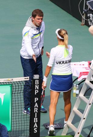 mikhail: KYIV, UKRAINE - APRIL 16, 2016: Captain of Ukraine National Team Mikhail Filima (L) and player Lesia Tsurenko during BNP Paribas FedCup game Ukraine vs Argentina at Campa Bucha Tennis Club in Kyiv