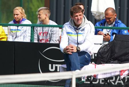 mikhail: KYIV, UKRAINE - APRIL 16, 2016: Captain of Ukraine National Team Mikhail Filima looks on during BNP Paribas FedCup game Lesia Tsurenko (Ukraine) v Nadia Podoroska (Argentina) at Campa Tennis Club Editorial