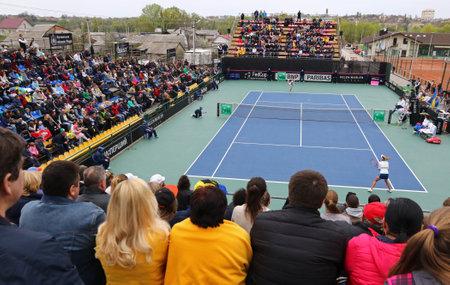 paribas: KYIV, UKRAINE - APRIL 16, 2016: People watch the BNP Paribas FedCup World Group II Play-off game Lesia Tsurenko of Ukraine vs Nadia Podoroska of Argentina at Campa Bucha Tennis Club in Kyiv, Ukraine