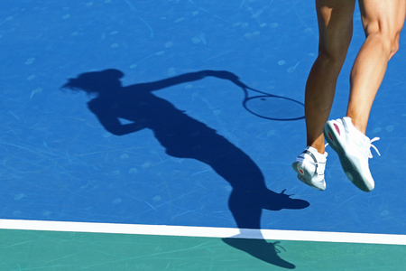 woman shadow: Shadow of woman tennis player, serving the ball Stock Photo