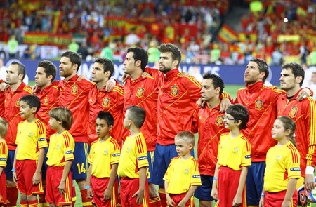 iniesta: KYIV, UKRAINE - JULY 1, 2012: Players of Spain football team sing the national anthen before UEFA EURO 2012 Final game against Italy at Olympic stadium in Kyiv, Ukraine